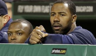 Atlanta Braves' Jason Heyward, right, and Atlanta Braves' Justin Upton stand in the dugout as Pittsburgh Pirates closer Jason Grilli strikes out the side to preserve a 3-1 Pirates' win during a baseball game in Pittsburgh Saturday, April 20, 2013. (AP Photo/Gene J. Puskar)