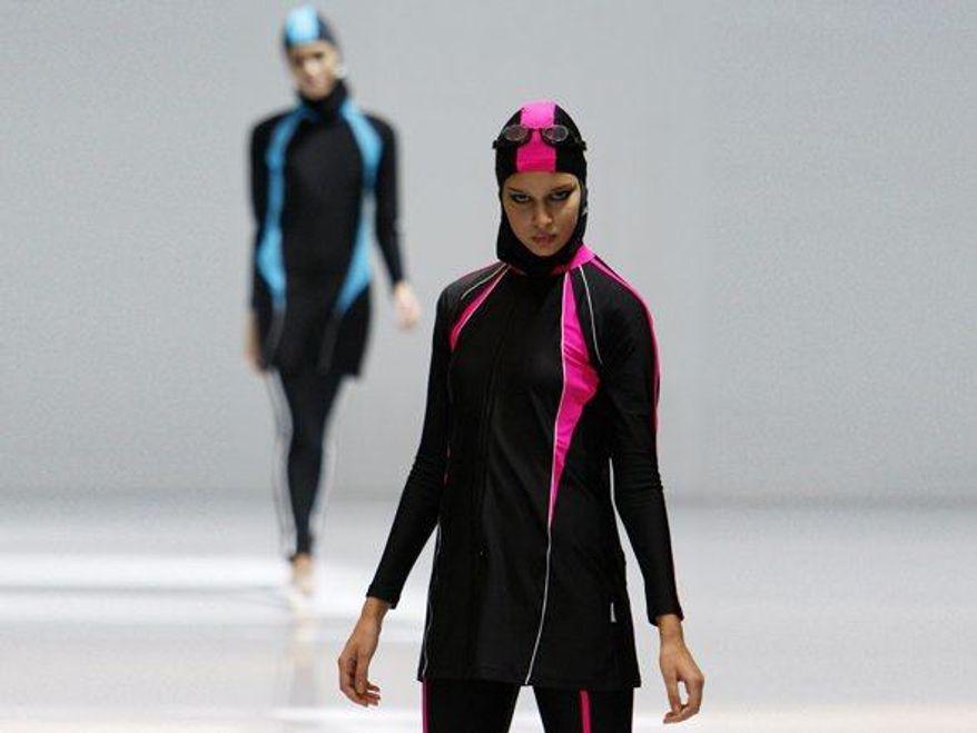 ** FILE ** A model showcases a swimsuit during the Islamic Fashion Festival at the Malaysia International Fashion Week in Kuala Lumpur, Malaysia, Nov. 3, 2010. (AP Photo/Lai Seng Sin)
