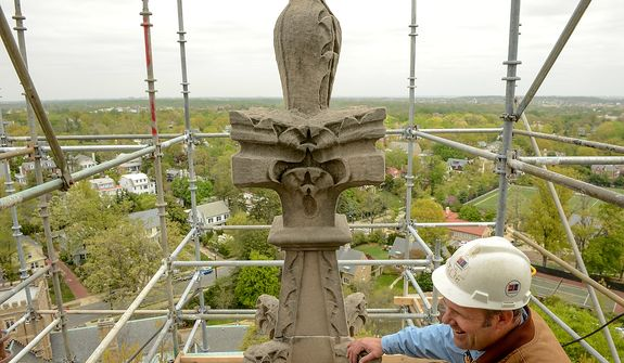 Head Stone Mason Joe Alonso stands on scaffolding which has been constructed to repair spires on the Washington National Cathedral which were damaged during a 5.8 magnitude earthquake in August of 2011, Washington, D.C., Monday, April 22, 2013. (Andrew Harnik/The Washington Times)