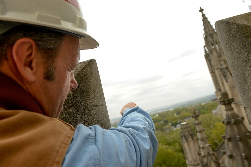 Head Stone Mason Joe Alonso points to spires that broke off the Washington National Cathedral during a 5.8 magnitude earthquake in August of 2011, Washington, D.C., Monday, April 22, 2013. (Andrew Harnik/The Washington Times)