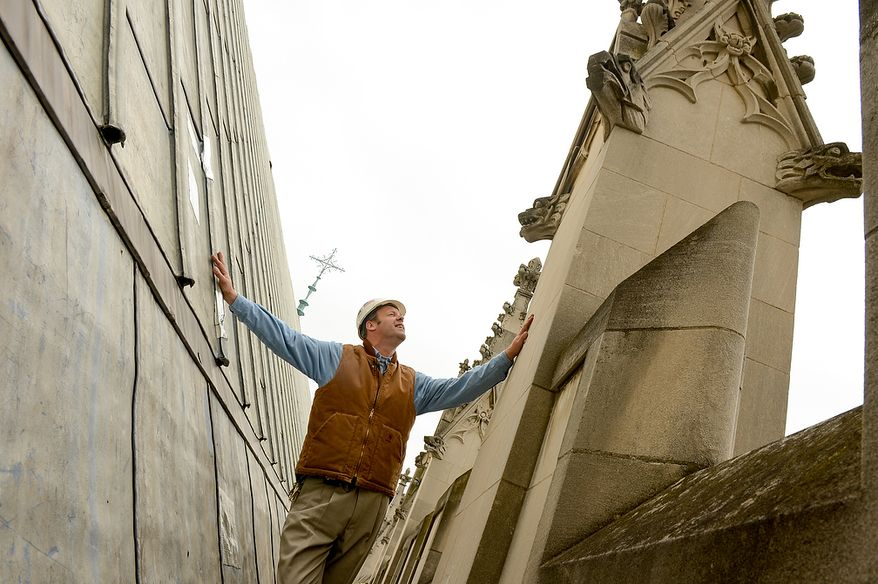 Head Stone Mason Joe Alonso looks up at a spire that broke apart and damaged the roof of the Washington National Cathedral during a 5.8 magnitude earthquake in August of 2011, Washington, D.C., Monday, April 22, 2013. (Andrew Harnik/The Washington Times)