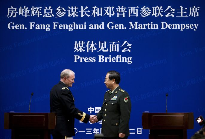 U.S. Army Gen. Martin E. Dempsey (left), chairman of the Joint Chiefs of Staff, shakes hands with his Chinese counterpart, Gen. Fang Fenghui, who is chairman of the General Staff, during their press briefing at the Bayi Building in Beijing on Monday, April 22, 2013. Gen. Fang said Beijing firmly opposes the North's nuclear weapons program and wants to work with others on negotiations to end it. (AP Photo/Andy Wong, Pool)