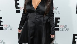 "Kim Kardashian from the reality show ""Keeping Up With the Kardashians"" attends the E! Network 2013 Upfront at the Manhattan Center on Monday, April 22, 2013, in New York. (Evan Agostini/Invision/AP)"