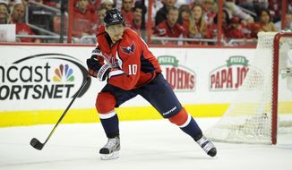 Washington Capitals left wing Martin Erat (10), of the Czech Republic, looks on during the first period of an NHL hockey game against the Tampa Bay Lightning, Saturday, April 13, 2013, in Washington. (AP Photo/Nick Wass)