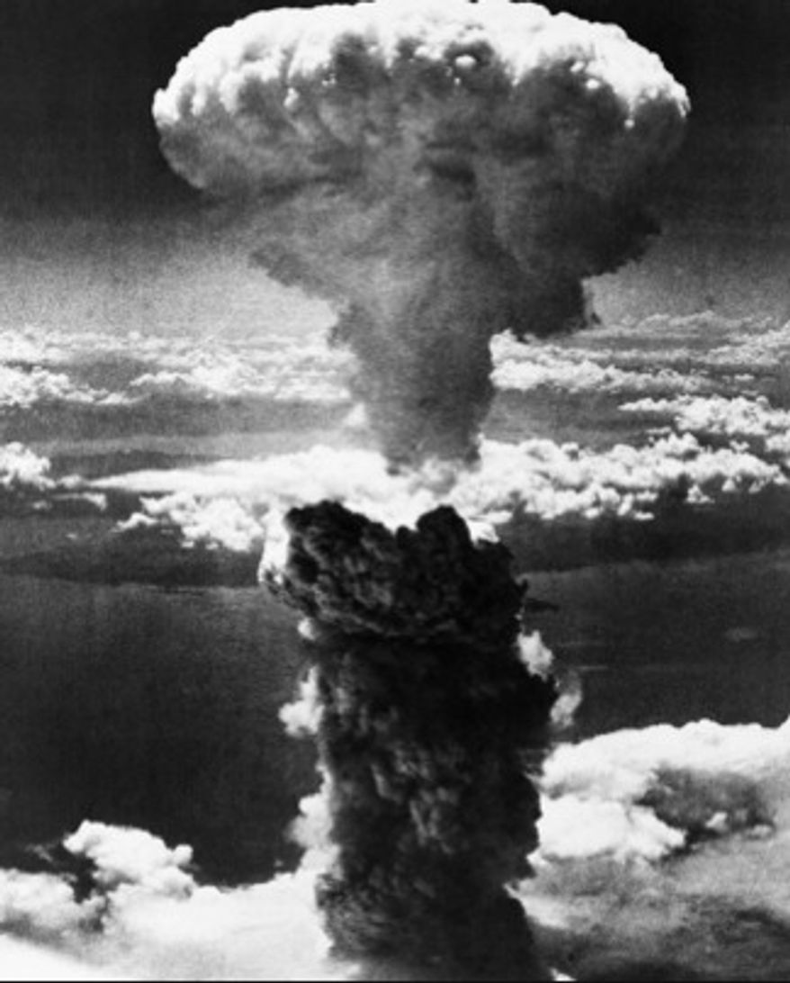 A mushroom cloud rises moments after the atomic bomb was dropped on Nagasaki, Japan, Aug. 9, 1945.
