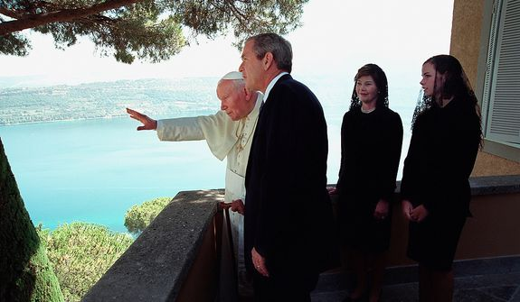 President George W. Bush, Mrs. Laura Bush and their daughter, Barbara, visit with His Holiness Pope John Paul II Monday, July 23, 2001, at the papal retreat Castel Gandolfo in Rome.  Photographs by Eric Draper from Front Row Seat: A Photographic Portrait of the Presidency of George W. Bush(Copyright © 2013). For more information visit www.utexaspress.com