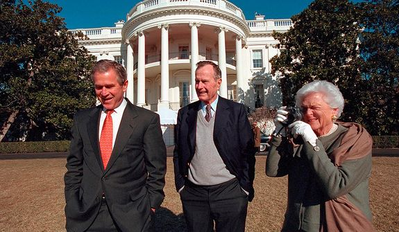 President George W. Bush walks with his parents, former President George H.W. Bush and Mrs. Barbara Bush on the South Lawn of the White House.   Photographs by Eric Draper from Front Row Seat: A Photographic Portrait of the Presidency of George W. Bush(Copyright © 2013). For more information visit www.utexaspress.com