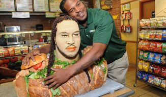 """Linebacker Jarvis Jones, 2013 draft prospect and newest Famous Fan of SUBWAY, unveils a life-size """"Smokehouse BBQ Chicken"""" sculpture to announce his official SUBWAY Famous Fan title, Tuesday, April 23, 2013, in New York. The sculpture is an artistic representation of the football star from the chest up, standing approximately three feet tall and made of almost entirely SUBWAY Smokehouse BBQ Chicken. Jarvis joins a roster of fellow Famous Fans that include Robert Griffin III, Justin Tuck, Michael Strahan, Blake Griffin and Michael Phelps.† (Photo by Diane Bondareff/Invision for SUBWAY/AP Images)"""