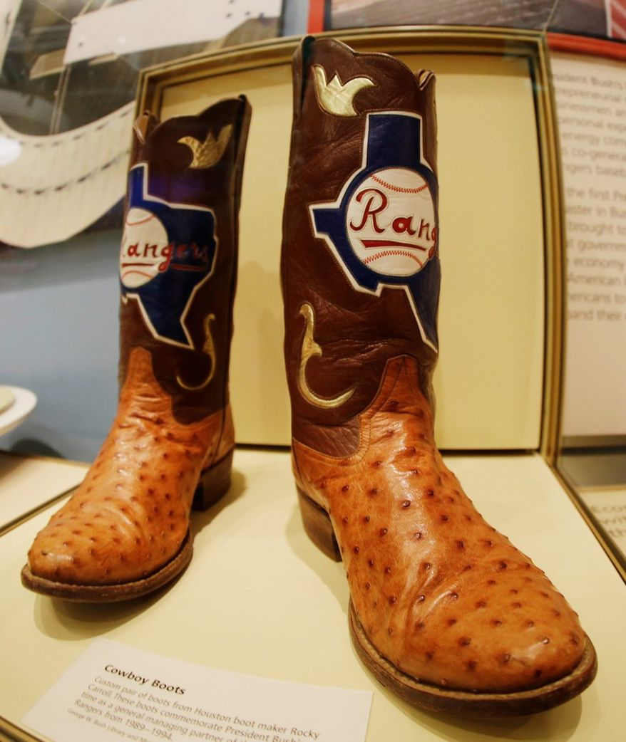 Boots commemorating the time Mr. Bush was general managing partner for the Texas Rangers are on display.