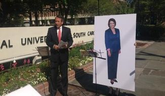"Former South Carolina Gov. Mark Sanford, who is the Republican candidate for the state's open House seat, held a ""debate"" Wednesday in Charleston, S.C., with a life-size poster-photo of House Speaker Nancy Pelosi because Mr. Sanford says his Democrat opponent, Elizabeth Colbert Busch, has refused to agree to multiple debates. (Courtesy of marksanford.com)"
