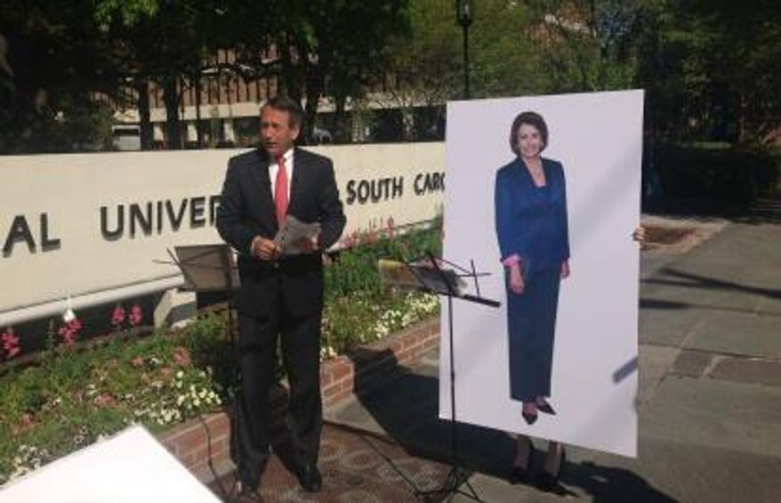"""Former South Carolina Gov. Mark Sanford, who is the Republican candidate for the state's open House seat, held a """"debate"""" Wednesday in Charleston, S.C., with a life-size poster-photo of House Speaker Nancy Pelosi because Mr. Sanford says his Democrat opponent, Elizabeth Colbert Busch, has refused to agree to multiple debates. (Courtesy of marksanford.com)"""