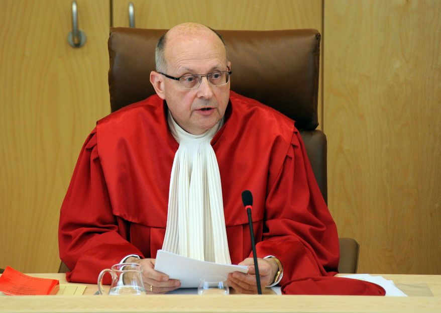 Presiding judge of the First Senate of the German Federal Constitutional Court Ferdinand Kirchhof announces its verdict on the anti-terrorism database in Karlsruhe, Germany, Wednesday, April 24, 2013. Germany's top court has upheld the legality of an anti-terrorism database, but has ordered the government to tweak how it is operated. (AP Photo/dpa, Uli Deck)