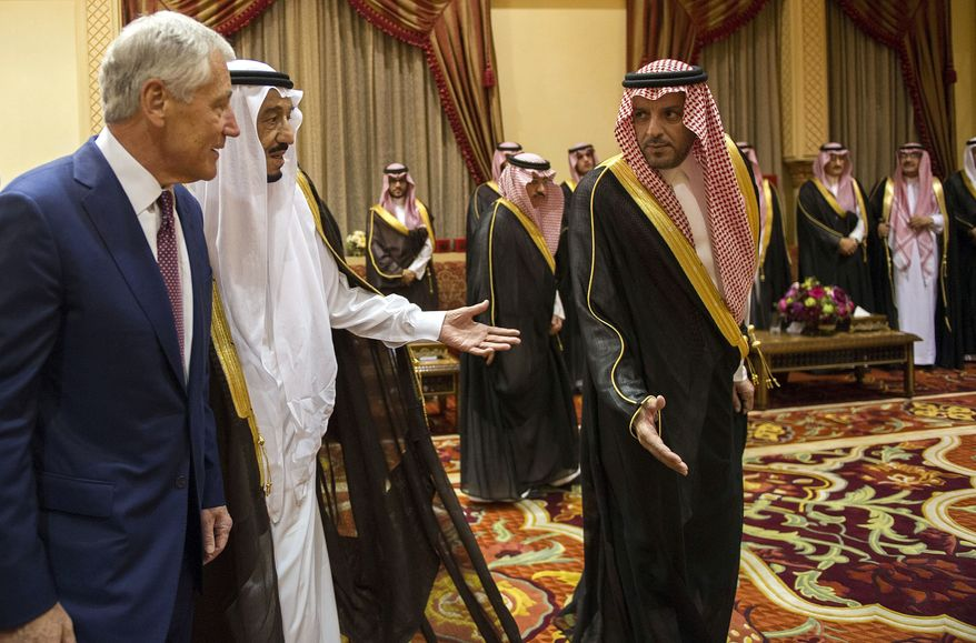 U.S. Secretary of Defense Chuck Hagel, left, is welcomed by Saudi Crown Prince, Deputy Premier and Minister of Defense Salman bin Abdulaziz , center, during a meeting at his residence in Riyadh, on Tuesday, April 23, 2013. (AP Photo/Jim Watson, Pool)