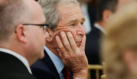 Former President George W. Bush participates in a signing ceremony for the joint use agreement between the National Archive and the George W. Bush Presidential Center Wednesday, April 24, 2013, in Dallas. Bush and his wife, Laura, attended Wednesday's ceremony in Dallas the day before the official dedication of the George W. Bush Presidential Center. The George W. Bush Foundation raised the money to build the center. The foundation donated the library and museum portion of the center to the National Archives, which provides access to presidential records, documents, historical materials and artifacts over time. (AP Photo/David J. Phillip)
