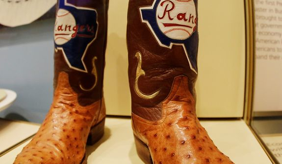 Cowboy boots commemorating the time George W. Bush served as general managing partner for the Texas Rangers, are seen during a tour of the George W. Bush Presidential Center Wednesday, April 24, 2013, in Dallas.  More than 8,000 people are expected to attend the invitation-only dedication of the center, Thursday, April 25, which will house the presidential library and museum along with the 43rd presidentís policy institute. It opens to the public on May 1.(AP Photo/David J. Phillip)