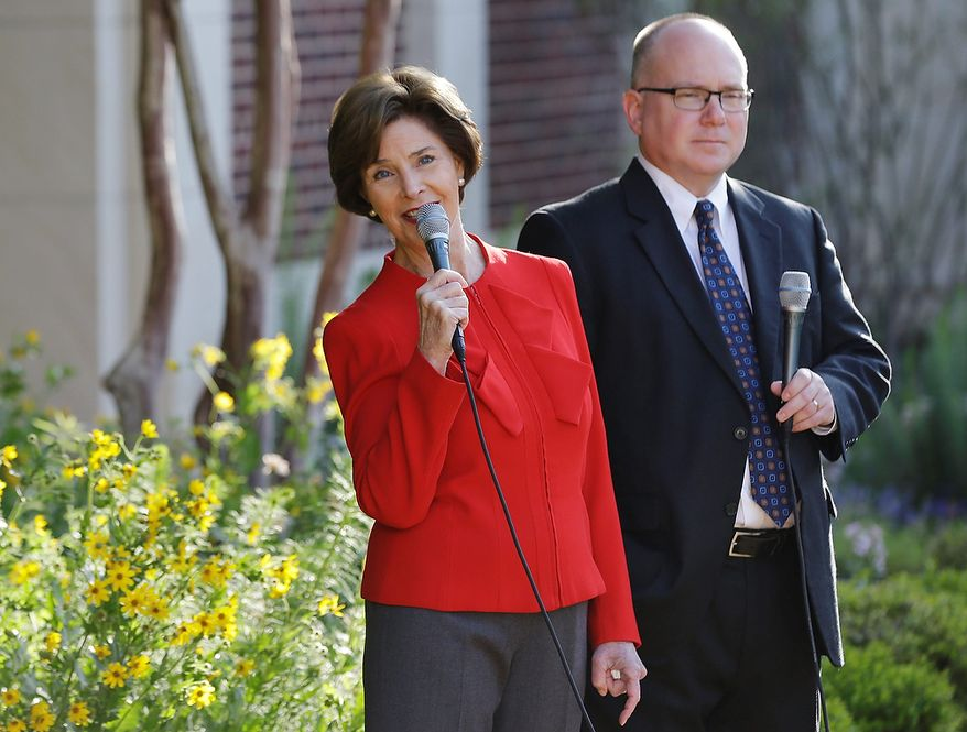 Former first lady Laura Bush and Alan Lowe, director of the library and museum speak during a media availability in the replica of the White House rose garden during a tour of the George W. Bush Presidential Center Wednesday, April 24, 2013, in Dallas. (AP Photo/David J. Phillip)
