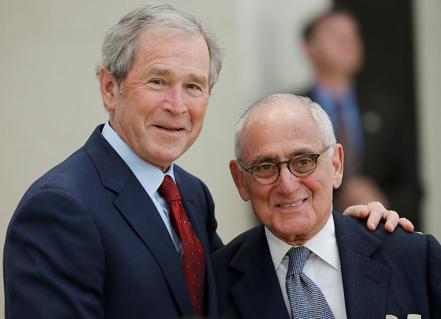 Former President George W. Bush, left, and center architect Robert A.M. Stern pause for a photo before the signing ceremony for the joint use agreement between the National Archive and the George W. Bush Presidential Center Wednesday, April 24, 2013, in Dallas.  Bush and his wife, Laura, attended Wednesday's ceremony in Dallas the day before the official dedication of the George W. Bush Presidential Center. The George W. Bush Foundation raised the money to build the center. The foundation donated the library and museum portion of the center to the National Archives, which provides access to presidential records, documents, historical materials and artifacts over time. (AP Photo/David J. Phillip)