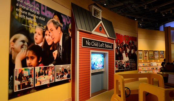 """In this photo taken April 16, 2013, an exhibit on the """"No Child Left Behind"""" initiative is shown in the museum area at the George W. Bush Presidential Library and Museum in Dallas. The museum uses everything from news clips to interactive screens to artifacts to tell the story of Bushís eight years in office. The George W. Bush Presidential Center, which includes the library and museum along with 43rd presidentís policy institute, will be dedicated Thursday on the campus of Southern Methodist University in Dallas. (AP Photo/Benny Snyder)"""