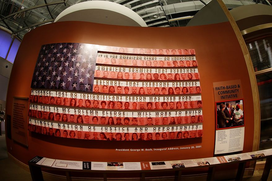 A display about the Bush administration's faith-based and community initiative is seen during a tour of the George W. Bush Presidential Center Wednesday, April 24, 2013, in Dallas.  More than 8,000 people are expected to attend the invitation-only dedication of the center, Thursday, April 25, which will house the presidential library and museum along with the 43rd presidentís policy institute. It opens to the public on May 1. (AP Photo/David J. Phillip)