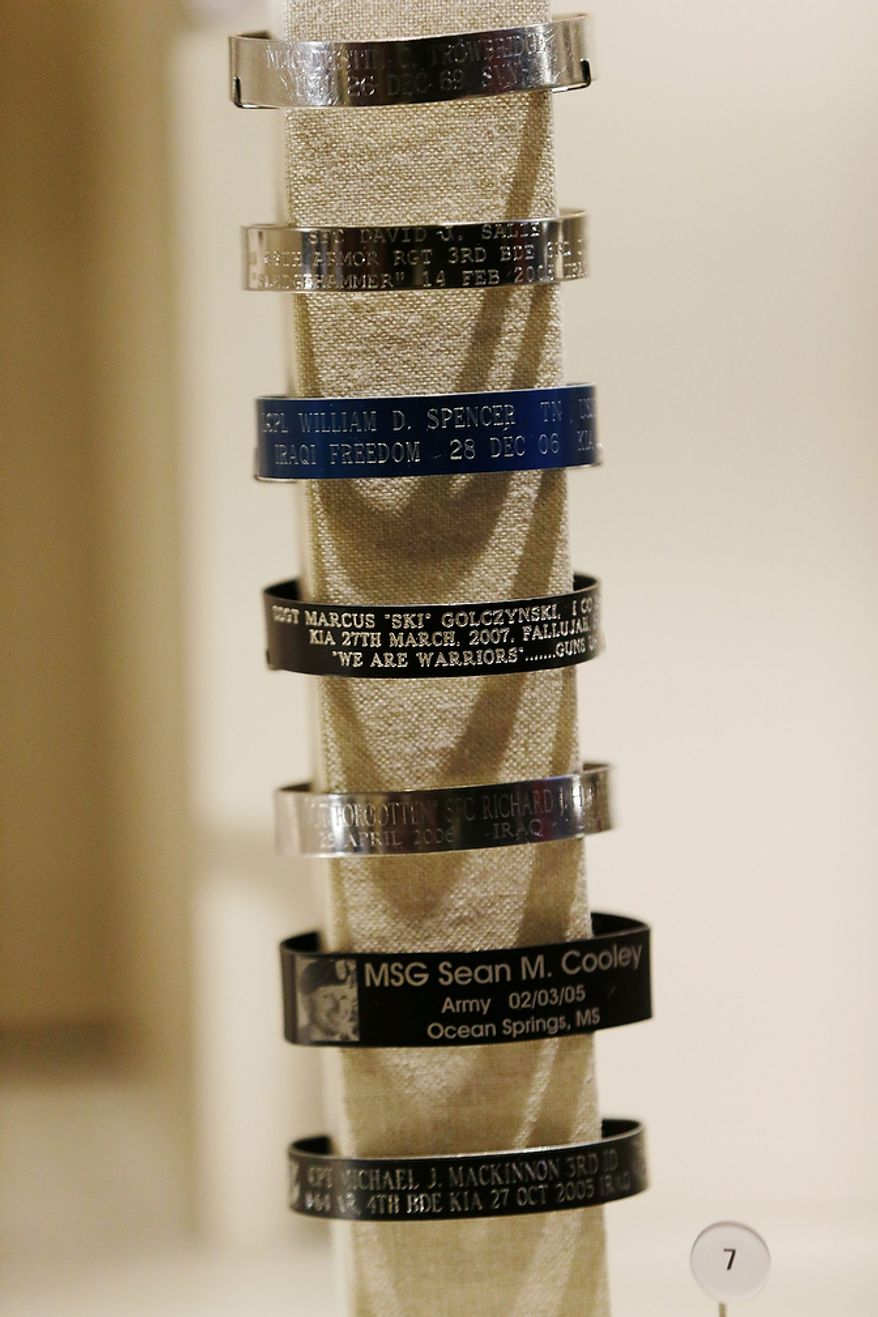 Memorial bracelets of captured or killed service members, that were given to President George W. Bush, are seen on display during a tour of the George W. Bush Presidential Center Wednesday, April 24, 2013, in Dallas.  More than 8,000 people are expected to attend the invitation-only dedication of the center, Thursday, April 25, which will house the presidential library and museum along with the 43rd presidentís policy institute. It opens to the public on May 1. (AP Photo/David J. Phillip)