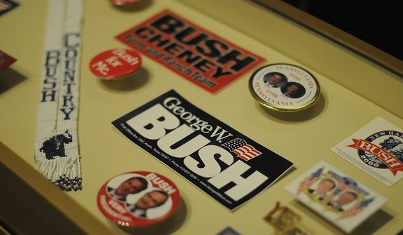 In this photo taken April 16, 2013, various campaign memorabilia is shown in the museum area at the George W. Bush Presidential Library and Museum in Dallas.  The museum uses everything from news clips to interactive screens to artifacts to tell the story of Bushís eight years in office.  The George W. Bush Presidential Center, which includes the library and museum along with 43rd presidentís policy institute, will be dedicated Thursday on the campus of Southern Methodist University in Dallas. (AP Photo/Benny Snyder)