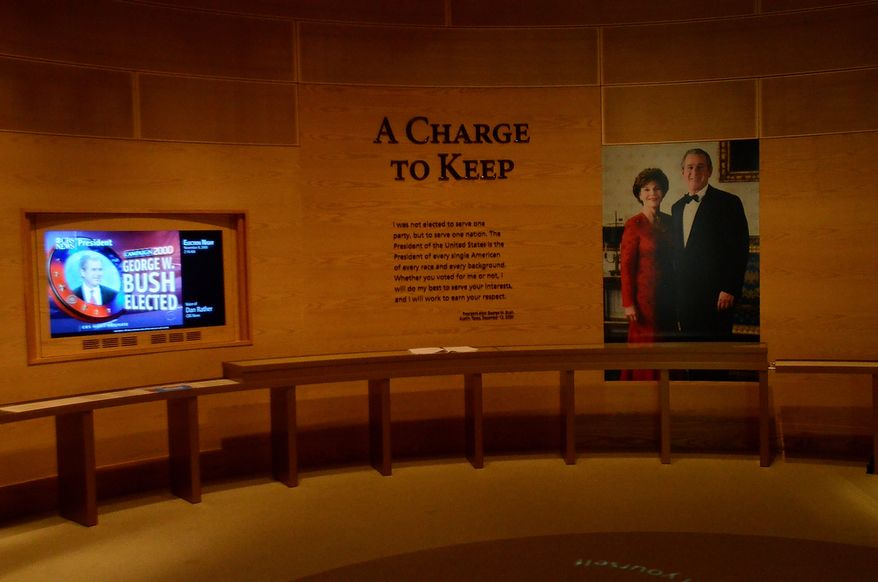 In this photo taken April 16, 2013, a portion an exhibit is shown in the museum area at the George W. Bush Presidential Library and Museum in Dallas. The museum uses everything from news clips to interactive screens to artifacts to tell the story of Bushís eight years in office. The George W. Bush Presidential Center, which includes the library and museum along with 43rd presidentís policy institute, will be dedicated Thursday on the campus of Southern Methodist University in Dallas. (AP Photo/Benny Snyder)