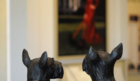 In this photo taken April 16, 2013, statues of Barney, left, and Miss Beazley, the beloved Scottish Terriers of president George W. Bush and Laura Bush, are seen in the museum area at the George W. Bush Presidential Library and Museum in Dallas.  The museum uses everything from news clips to interactive screens to artifacts to tell the story of Bushís eight years in office. The George W. Bush Presidential Center, which includes the library and museum along with 43rd presidentís policy institute, will be dedicated Thursday on the campus of Southern Methodist University in Dallas. (AP Photo/Benny Snyder)