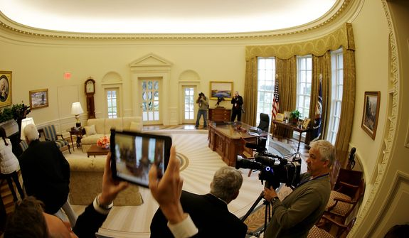 A replica of the Oval Office is seen during a tour of the George W. Bush Presidential Center Wednesday, April 24, 2013, in Dallas.  More than 8,000 people are expected to attend the invitation-only dedication of the center, Thursday, April 25, which will house the presidential library and museum along with the 43rd presidentís policy institute. It opens to the public on May 1.  (AP Photo/David J. Phillip)
