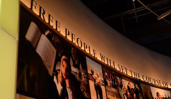 In this photo taken April 16, 2013, an exhibit displaying various images of freedom and democracy are seen in the museum area at the George W. Bush Presidential Library and Museum in Dallas. The museum uses everything from news clips to interactive screens to artifacts to tell the story of Bushís eight years in office. The George W. Bush Presidential Center, which includes the library and museum along with 43rd presidentís policy institute, will be dedicated Thursday on the campus of Southern Methodist University in Dallas. (AP Photo/Benny Snyder)