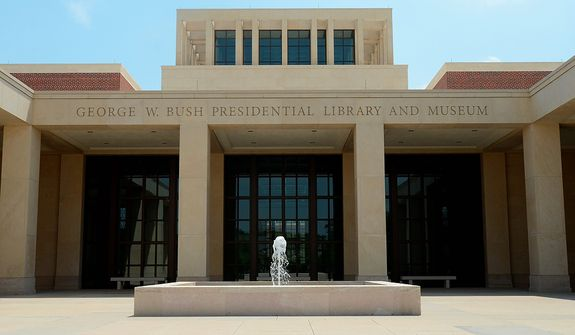 In this photo taken April 16, 2013, the main entrance courtyard is shown at the George W. Bush Presidential Library and Museum in Dallas. The museum uses everything from news clips to interactive screens to artifacts to tell the story of Bushís eight years in office. The George W. Bush Presidential Center, which includes the library and museum along with 43rd presidentís policy institute, will be dedicated Thursday on the campus of Southern Methodist University in Dallas. (AP Photo/Benny Snyder)