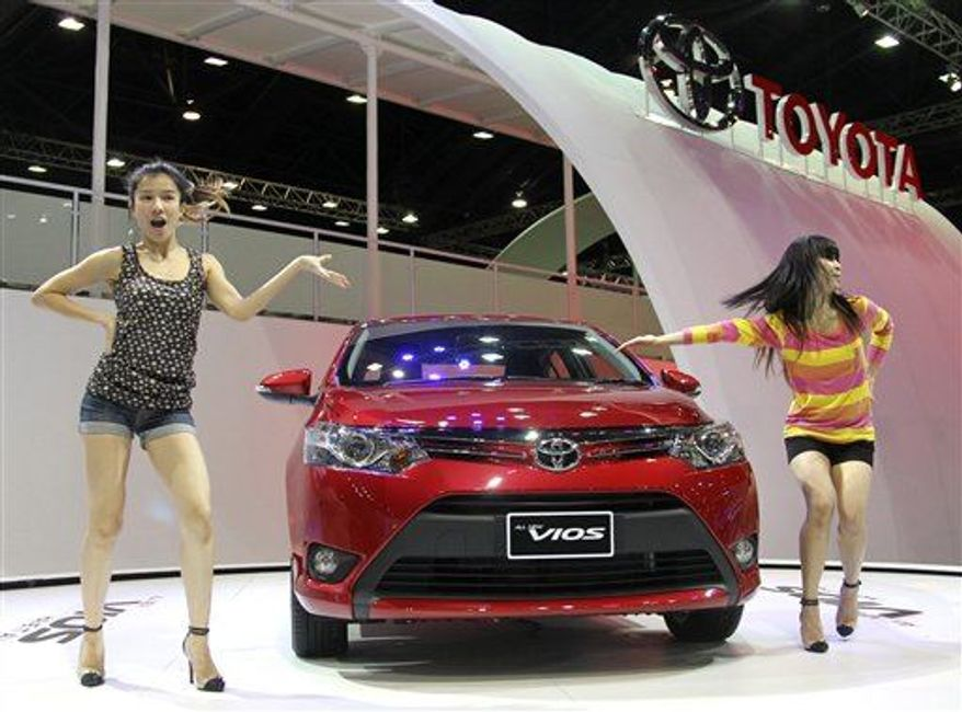 Dancers introduce a brand-new compact sedan Toyota Vios on the press day of the Bangkok Motor Show in Bangkok, Thailand, March 26, 2013. (Associated Press)