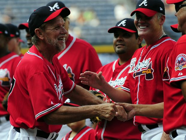Former Atlanta Braves pitcher Rick Camp, center left, greets other former Braves players for a Braves Legends Game featuring the 1991 Braves against all other Braves alumni, on Saturday, Aug. 13, 2011 in Atlanta, before a baseball game against the Chicago Cubs. (AP Photo/Dave Tulis)