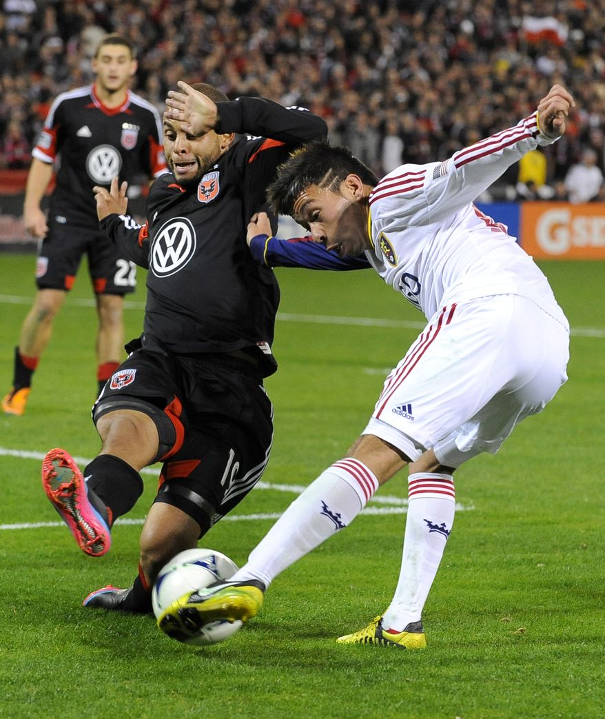 Real Salt Lake midfielder Sebastian Velasquez, right, reaches the ball ahead of D.C. United midfielder Kyle Porter during the second half of an MLS soccer game, Saturday, March 9, 2013, in Washington. United won 1-0. (AP Photo/Richard Lipski)