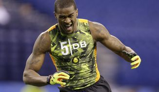 Mississippi State defensive back Johnthan Banks runs a drill at the NFL football scouting combine in Indianapolis, Tuesday, Feb. 26, 2013. (AP Photo/Michael Conroy)