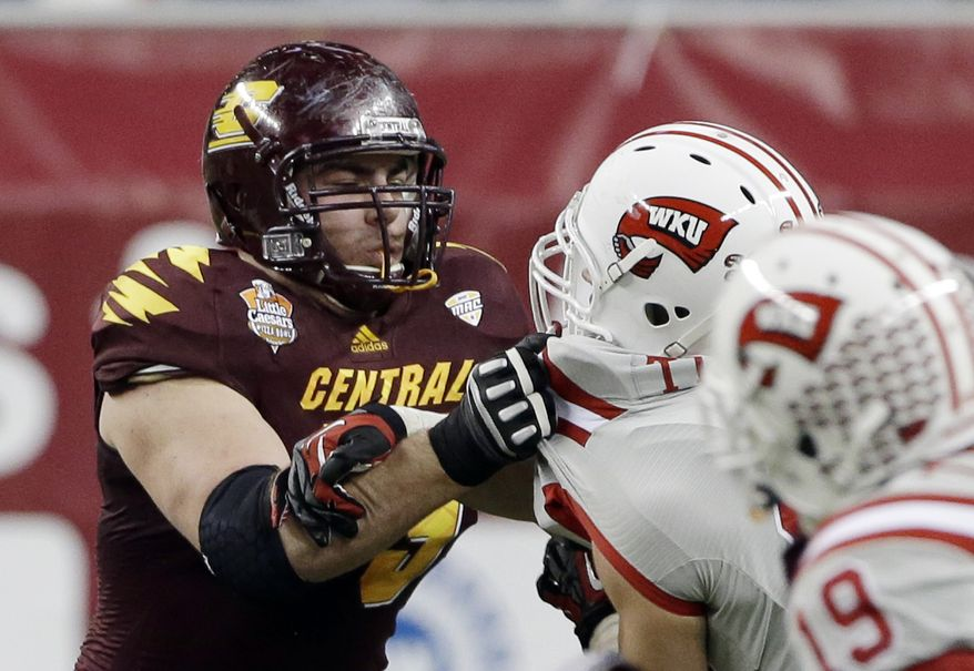 FILE - In this Dec. 26, 2012, file photo, Central Michigan offensive linesman Eric Fisher blocks against Western Kentucky during the second half of the Little Caesars Pizza Bowl NCAA college football game at Ford Field in Detroit. Only twice since the AFL-NFL merger in 1970 has an offensive tackle been drafted first overall. On Thursday night, the Kansas City Chiefs could make it three. Luke Joeckel and Fisher are the hot names to go No. 1, assuming the Chiefs still have the pick. (AP Photo/Carlos Osorio, File)