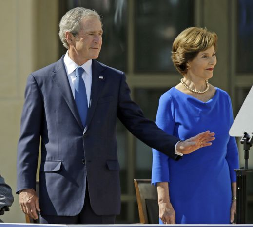 Former president George W. Bush and his wife, Laura, arrive April 25, 2013, at the dedication of the George W. Bush Presidential Center in Dallas. (Associated Press)