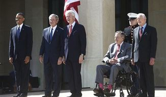 President Obama stands with former presidents George W. Bush, Bill Clinton, George H.W. Bush, and Jimmy Carter at the dedication of the George W. Bush presidential library on the campus of Southern Methodist University in Dallas, Thursday, April 25, 2013. (AP Photo/Charles Dharapak)