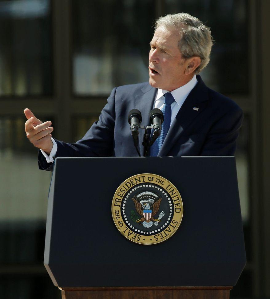 Former president George W. Bush speaks during the dedication of the George W. Bush Presidential Center Thursday, April 25, 2013, in Dallas. (AP Photo/David J. Phillip)