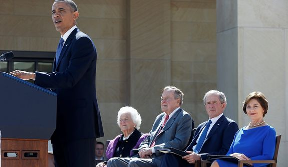 President Barack Obama speaks during the dedication of the George W. Bush presidential library on the campus of Southern Methodist University in Dallas, Thursday, April 25, 2013. Seated, from left are, former first lady Barbara Bush, former President George H.W. Bush, former President George W. Bush, and his wife, former first lady Laura Bush.  (AP Photo/Charles Dharapak)