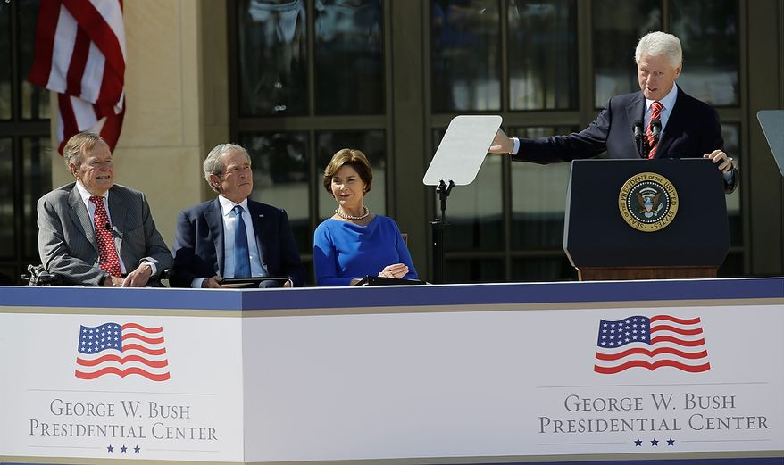 From left, President George H.W. Bush, former president George W. Bush and Laura Bush listen to former president William J. Clinton during the dedication of the George W. Bush Presidential Center Thursday, April 25, 2013, in Dallas. (AP Photo/David J. Phillip)
