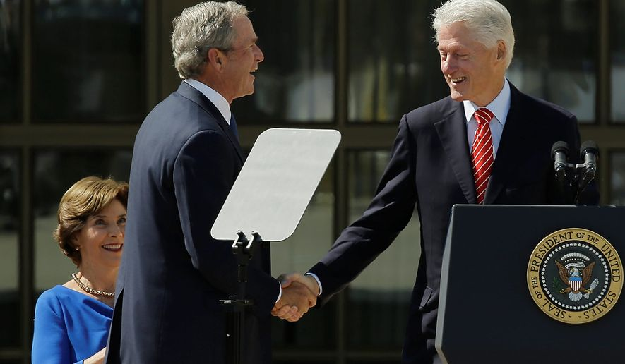 Former president George W. Bush, left, shakes hands with former president William J. Clinton during the dedication of the George W. Bush Presidential Center Thursday, April 25, 2013, in Dallas. (AP Photo/David J. Phillip)