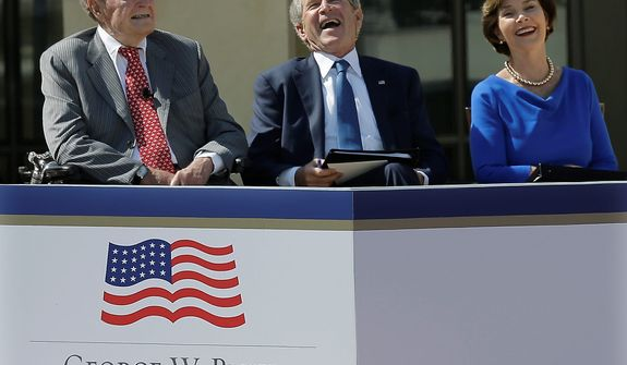 Former President George H.W. Bush and former president George W. Bush and his wife Laura Bush laugh while former president William J. Clinton speaks during the dedication of the George W. Bush Presidential Center Thursday, April 25, 2013, in Dallas. (AP Photo/David J. Phillip)