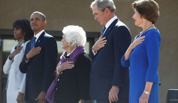 President Barack Obama stands with first lady Michelle Obama, former first lady Barbara Bush, former President George W. Bush, and Laura Bush at the dedication of the George W. Bush presidential library on the campus of Southern Methodist University in Dallas, Thursday, April 25, 2013. (AP Photo/Charles Dharapak)