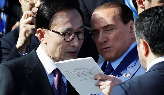 Former South Korean Lee Myung-bak, left, speaks with Italian Prime Minister Silvio Berlusconi before the dedication of the George W. Bush Presidential Center Thursday, April 25, 2013, in Dallas. (AP Photo/David J. Phillip)
