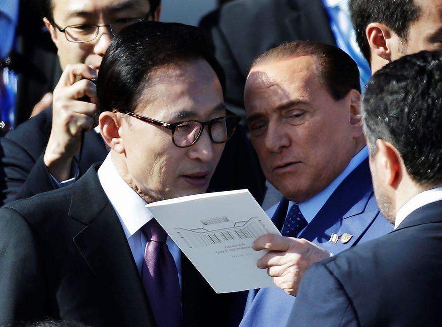 Former South Korean Lee Myung-bak, left, speaks with Italian Prime Minister Silvio Berlusconi before the dedication of the George W. Bush Presidential Center Thursday, April 25, 2013, in Dallas. (AP Photo/David J. Phillip)