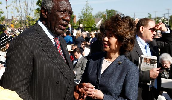 Former Ghana President John Kufuor, left, speaks with former Labor Secretary Elaine Chao at the dedication of the George W. Bush presidential library on the campus of Southern Methodist University in Dallas, Thursday, April 25, 2013. (AP Photo/Charles Dharapak)