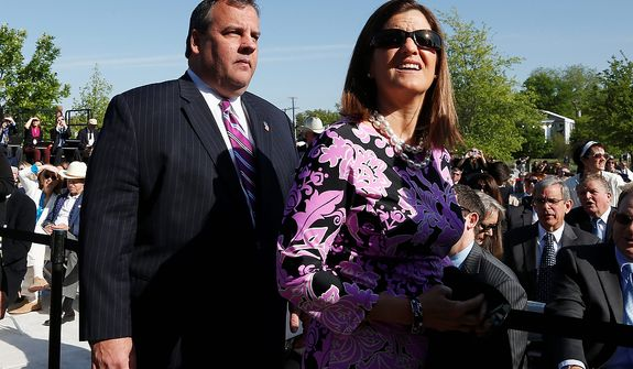 New Jersey Gov. Chris Christie and wife Mary Pat arrive at the dedication of the George W. Bush presidential library on the campus of Southern Methodist University in Dallas, Thursday, April 25, 2013. (AP Photo/Charles Dharapak)