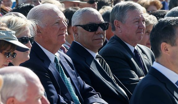 Former Secretary of State Colin Powell, center, flanked by former Attorney General John Ashcroft, right, and former Secretary of State James A. Baker III, listen during  dedication of the George W. Bush presidential library on the campus of Southern Methodist University in Dallas, Thursday, April 25, 2013. (AP Photo/Charles Dharapak)