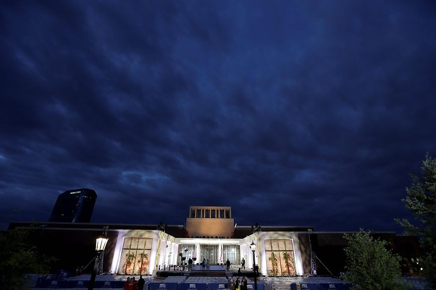 Production crews put the finishing touches on the stage before the dedication ceremony of the George W. Bush Presidential Center, Thursday, April 25, 2013, in Dallas. (AP Photo/David J. Phillip)