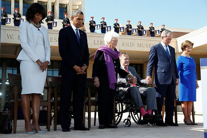 President Barack Obama and first lady Michelle Obama stand with former Presidents George W. Bush, George H.W. Bush, and their wives, former first ladies Barbara Bush, and Laura Bush amd bow their heads in prayer at the dedication of the George W. Bush presidential library on the campus of Southern Methodist University in Dallas, Thursday, April 25, 2013. (AP Photo/Charles Dharapak)